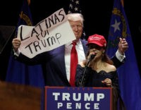 A Latino supporter speaks on stage with Republican presidential candidate Donald Trump during a campaign rally at the Venetian Hotel on October 30, 2016 in Las Vegas, Nevada. / AFP / John GURZINSKI (Photo credit should read JOHN GURZINSKI/AFP/Getty Images)