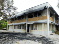 A general view shows damage to the Australian Christian Lobby after a burning van hit the group's headquarters in Canberra on December 22, 2016.