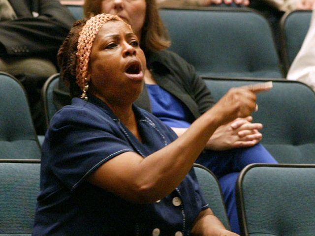 Sandra Crenshaw, center, interupts a Dallas City Council meeting, Wednesday, Aug. 27, 2003, to protest the firing of Police Chief Terrell Bolton. He was dismissed Tuesday by city manager Ted Benavides, who didn't offer a specific reason. (AP Photo/Donna McWilliam)