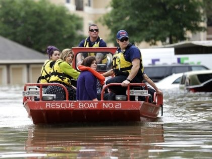 Residents are evacuated from their flooded apartment complex Tuesday, April 19, 2016, in Houston. Storms have dumped more than a foot of rain in the Houston area, flooding dozens of neighborhoods. (AP Photo/David J. Phillip)