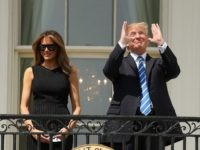 President Donald Trump, accompanied by first lady Melania Trump, gestures at the White House in Washington, Monday, Aug. 21, 2017, as they viewed the solar eclipse. (AP Andrew Harnik)