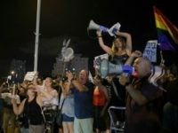 Israelis take part in a weekly protest against Israeli Prime Minister Benjamin Netanyahu, seen on the poster, in front of the home of Israel's attorney general Avichai Mandelblit in Petah Tikva. Saturday, Aug. 26, 2017. The weekly vigils have become the vanguard of a grassroots protest movement against Netanyahu's alleged …