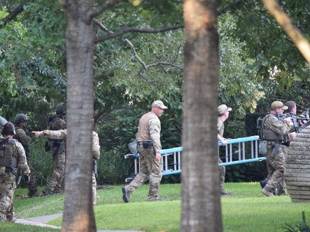 FBI agents execute a search warrant on a home where they suspect bomb-making materials are stored. (Photo: Bob Price/Breitbart Texas)
