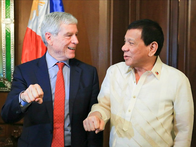 President Rodrigo Roa Duterte does his signature pose along with Australian Secret Intelligence Service Director General Nicolas Peter 'Nick' Warner who paid a courtesy call on the President in Malacañan Palace on August 22, 2017. ALBERT ALCAIN/PRESIDENTIAL PHOTO