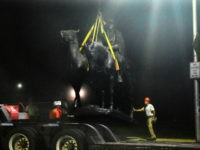 "Workers removed the Robert E. Lee and Thomas J. ""Stonewall"" Jackson monument in Baltimore during the night. Credit Jerry Jackson/The Baltimore Sun, via Associated Press"