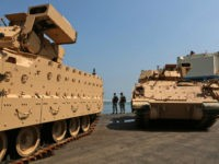 Lebanese soldiers guard US made Bradley Fighting Vehicles at the port of Beirut on August 14, 2017. The US Army is sending a total of 50 Bradley armored vehicles to the Lebanese army as it is assisting the latter with weapons, equipment and training to boost its capabilities. / AFP …