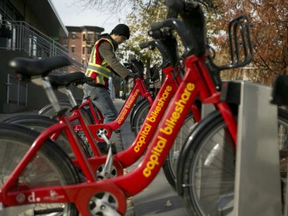Diego Jaramillo adds a Capital Bikeshare bicycle to a docking station in Washington, D.C., U.S., on Friday, Nov. 30, 2012. Since Sept. 2010, Capital Bikeshare has dispersed more than 1700 bikes for rent across the city and has totaled over 3.5 million rides since Sept. 2011. Alta Bicycle Share, the …