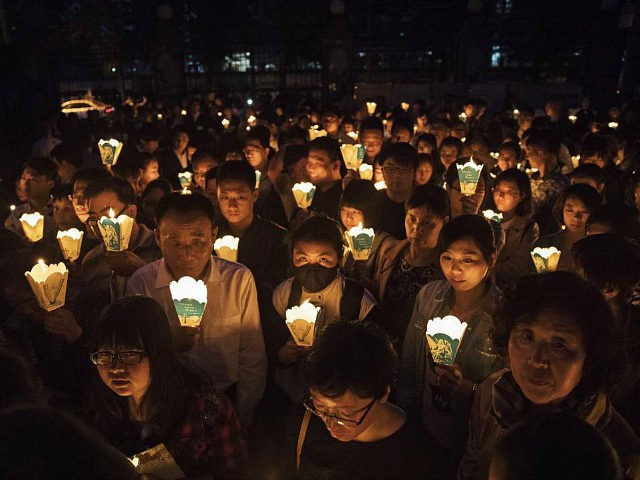 BEIJING, CHINA - APRIL 15: Chinese Catholics hold candles at a mass on Holy Saturday during Easter celebrations at the government sanctioned West Beijing Catholic Church on April 15, 2017 in Beijing, China. China, an officially atheist country, places a number of restrictions on Christians, allowing legal practice of the faith only at state-approved churches. The policy has driven an increasing number of Christians and Christian converts 'underground' to congregations in private homes and other venues. While the size of the religious community is difficult to measure, studies estimate there are more than 80 million Christians inside China; some studies support the possibility it could become the most Christian nation in the world in the coming years. Officially there have been no relations between China and the Vatican since the country's modern founding in 1949 though in recent years there have been signs of warming relations between Chinese president Xi Jinping and Pope Francis that could possibly allow greater religious freedom in the future. At present, the split means approved Chinese Christians worship within a state-sanctioned Church known as the Patriotic Association which regards the Communist Party as its leader, not the Pope in Rome. (Photo by Kevin Frayer/Getty Images)