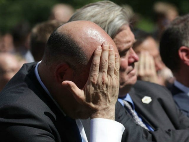 WASHINGTON DC- JUNE 01 National Economic Council Director Gary Cohn wipes away sweat while listening to President Donald Trump announce his decision for the United States to pull out of the Paris climate agreement in the Rose Garden at the White House