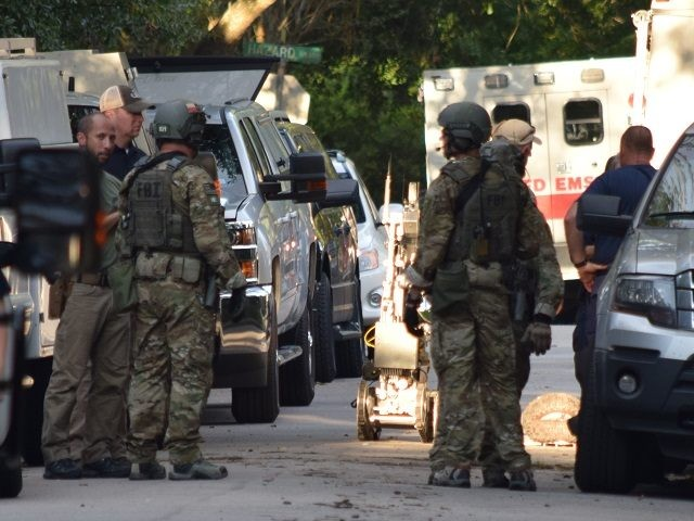 An FBI bomb robot returns from the home where Andrew Schneck reportedly stored bomb-making materials. (Photo: Bob Price/Breitbart Texas)