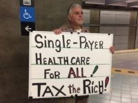 Single-Payer Health Care protester (Joel Pollak / Breitbart News)