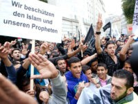 Muslims protest infront of the US embassy on September 22, 2012 in Vienna. Protests against the film, which mocks Islam and was made by extremist Christians, have erupted across the world, leading to more than 50 deaths since the first demonstrations on September 11. AFP PHOTO / DIETER NAGL (Photo …