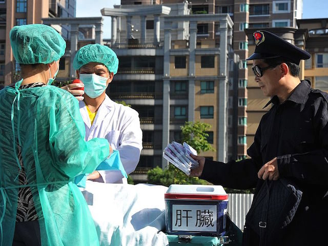 "Members of the spiritual movement Falungong act out a scene of stealing human organs to sell during a demonstration in Taipei on July 20, 2014 against China's persecution of the group. China outlawed Falungong as an ""evil cult"" in 1999 and has since detained tens of thousands of members. AFP …"