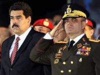 Venezuelan President Nicolas Maduro (C), First Lady Cilia Flores (L) and Defense Minister Vladimir Padrino Lopez (R) attend the commemoration of the 190 years of the Battle of Ayacucho and grade promotion ceremony of the Bolivarian National Armed Forces at the National Pantheon in Caracas, on December 9, 2014. AFP PHOTO/FEDERICO PARRA (Photo credit should read FEDERICO PARRA/AFP/Getty Images)