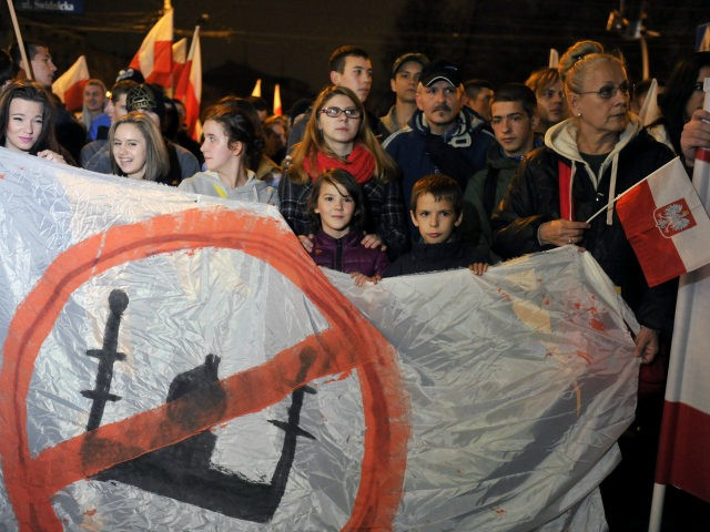 Right-wing nationalist protesters hold a banner with crossed out mosque during the annual march that coincides with Poland's National Independence Day in Wroclaw on November 11, 2015. Poland's National Independence Day commemorates the anniversary of the Restoration of a Polish State in 1918. PHOTO / NATALIA DOBRYSZYCKA (Photo credit should …