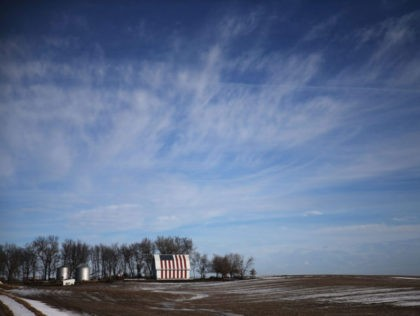 DES MOINES, IA - JANUARY 30: An American flag is seen painted on a barn on January 30, 2016 outside of Des Moines, Iowa. Candidates who are seeking the nominations from the Republican and Democratic Party are touring the state campaigning for votes before the Iowa caucus that takes place …