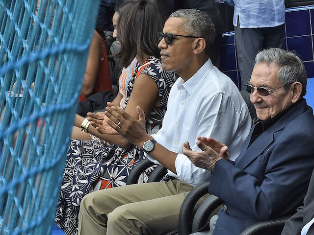 US President Barack Obama and Cuban President Raul Castro (R) applaud during a Major League baseball exhibition game between the Tampa Bay Rays and the Cuban national team at the Latinoamericano stadium in Havana on March 22, 2016. Obama praised the bravery of Cuban dissidents Tuesday in a meeting at …