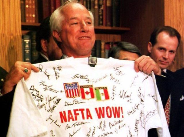 """WASHINGTON, DC - NOVEMBER 17: During a Capitol Hill news conference late 17 November 1993 with supporters of the North American Free Trade Agreement, U.S. Representative Jim Kolbe, R-Arizona, holds up a t-shirt signed by other members of the House of Representatives bearing the slogan """"NAFTA Wow!"""" after the House …"""