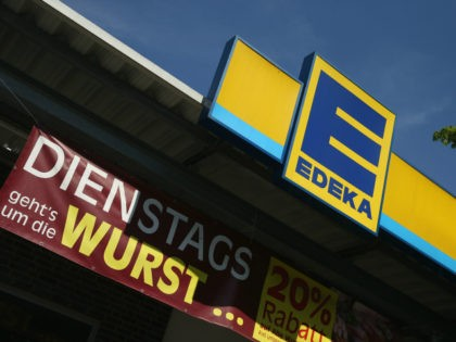 BERLIN, GERMANY - MAY 10: An Edeka supermarket stands on May 10, 2016 in Berlin, Germany. German anti-cartel authorities announced yesterday they are charging Edeka as well as chains Metro, Netto and Rewe with price fixing of the three brands Beck's, Franziskaner and Hasseroeder with the beer companies' parent, Anheuser-Busch. …