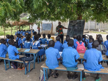 A teacher conduct his class under a tree in Moho, a village in the Northern Province of Cameroon on September 16, 2016. / AFP / REINNIER KAZE (Photo credit should read REINNIER KAZE/AFP/Getty Images)