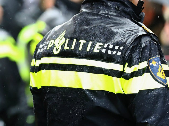 BREDA, NETHERLANDS - MARCH 08: A general view of the police as they protect PVV Candidate, Geert Wilders (not in frame) as he speaks to the crowd, hands out pamphlets or flyers and poses for selfies on his election campaign near Van Coothplein on March 8, 2017 in Breda, Netherlands. …