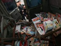 NANJING, CHINA - JANUARY 10: (CHINA OUT) Law enforcement officers prepare to transport confiscated piracy and pornographic DVDs during a raid to shops on January 10, 2007 in Nanjing of Jiangsu Province, China. According to the Ministry of Culture, China has launched an extensive campaign for the sixth consecutive year …