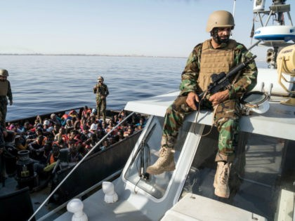 A Libyan coast guardsman watches over during an operation to rescue illegal immigrants who attempted to reach Europe off the coastal town of Zawiyah, 45 kilometres west of the capital Tripoli, on June 27, 2017. More than 8,000 migrants have been rescued in waters off Libya during the past 48 …