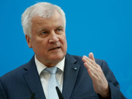 Horst Seehofer, leader of the conservative Christian Democratic Union's (CDU) Bavarian sister Party CSU, gestures during a press conference to present the electoral programme of the conservative CDU/CSU union for the September 24 parliamentary election on July 3, 2017 in Berlin. / AFP PHOTO / Odd ANDERSEN (Photo credit should …