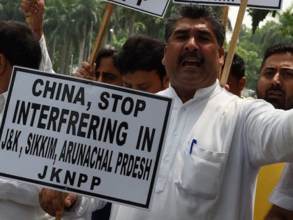 Indian activists of the Jammu and Kashmir National Panthers Party protest outside the Chinese embassy in New Delhi on July 7, 2017, in the wake of border tensions between the neighbouring countries. China has warned that the withdrawal of Indian troops from disputed territory was a precondition for peace as …