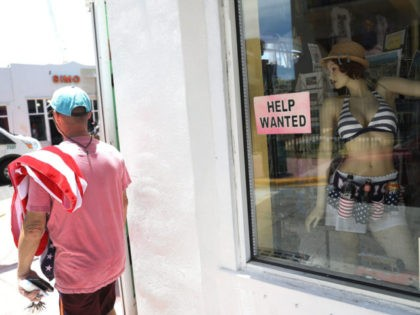 MIAMI, FL - JULY 07: A help wanted sign is seen in a window of a business on July 7, 2017 in Miami, Florida. The U.S. Labor Department released the jobs report which showed that 222,000 jobs were added last month. (Photo by Joe Raedle/Getty Images)