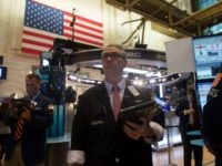 A trader works on the floor at the closing bell of the Dow Industrial Average at the New York Stock Exchange on August 8, 2017 in New York. Wall Street stocks fell Tuesday amid rising tensions between the US and North Korea, bringing the Dow's streak of nine straight records …