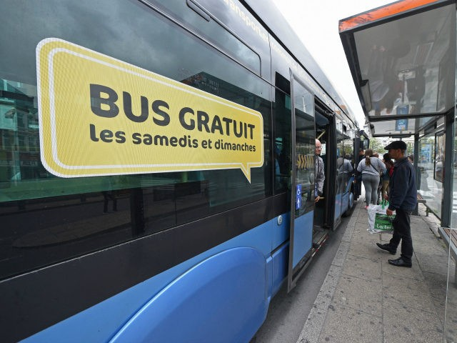 People wait to board a bus advertising a free bus service on saturdays and sundays in the northern city of Dunkerque on July 23, 2017. / AFP PHOTO / FRANCOIS LO PRESTI (Photo credit should read FRANCOIS LO PRESTI/AFP/Getty Images)