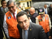 Guatemalan President Jimmy Morales and Vice-President Jafeth Cabrera (L) arrive at the headquarters of Guatemala's National Coordinator for Disaster Reduction (CONRED) in Guatemala City to offer a press conference after a strong earthquake hit the country on June 14, 2017. A strong 6.9 magnitude earthquake hit western Guatemala early on …