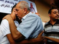 Hamdan Timraz, assistant regional director of the United Nations Department for Safety and Security in the Gaza Strip, embraces his son after his release upon arrival in Gaza City on August 8, 2017, after he was held in detention by Israel upon crossing the Beit Hanun crossing in early July. / AFP PHOTO / MOHAMMED ABED (Photo credit should read MOHAMMED ABED/AFP/Getty Images)
