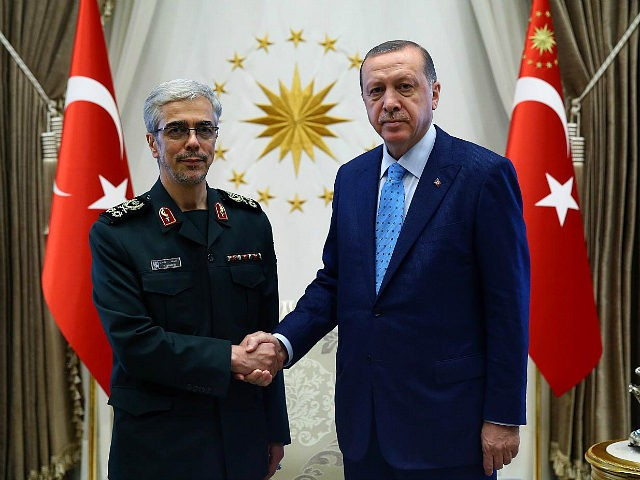 ANKARA, TURKEY - AUGUST 16: President of Turkey Recep Tayyip Erdogan (R) shakes hands with General Staff of the Armed Forces of Iran, Mohammad Bagheri (L) ahead of their meeting at Presidential Complex in Ankara, Turkey on August 16, 2017. (Photo by Kayhan Ozer/Anadolu Agency/Getty Images)
