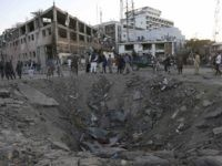 Kabul Afghanistan crater (Rahman Gul / Associated Press)