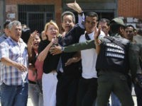 Venezuelan General Prosecutor Luisa Ortega Diaz, third left, is surrounded by loyal employees of the General Prosecutor's office, as she was barred from entering her office by security forces, outside of the General Prosecutor headquarters in Caracas, Venezuela, Saturday, Aug. 5, 2017. Security forces surrounded the entrance ahead of a …