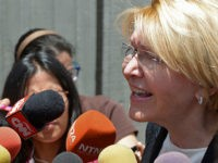 Venezuela's dismissed chief prosecutor Luisa Ortega, one of President Nicolas Maduro's most vocal critics, speaks to the press after the 'In Defence of Democracy Forum' held by the opposition in Caracas on August 6, 2017 a day after a new assembly with supreme powers and loyal to President Nicolas Maduro …