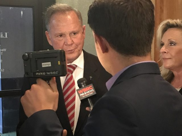 Roy Moore speaks to reports at the Jefferson County Republican Executive Committee Meeting on August 10.