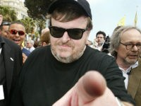 Michael Moore Sprays 'Flint Water' at Michigan Capitol, Demands Governor Snyder Drink It