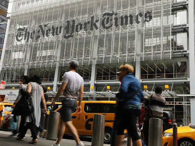 People walk past the New York Times building on July 27, 2017 in New York City. The New York Times Company shares have surged to a nine-year high after posting strong earnings on Thursday. Partly due to new digital subscriptions following the election of Donald Trump as president, the company …