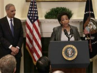 Attorney General nominess Loretta Lynch (C) speaks after U.S. President Barack Obama (R) introduced here as his nominee to replace Eric Holder (L) during a ceremony in the Roosevelt Room of the White House November 8, 2014 in Washington, DC. Lynch has recently been the top U.S. prosecutor in Brooklyn, and would be the first African American woman to hold the position of Attorney General if confirmed. (Photo by Win McNamee/Getty Images)