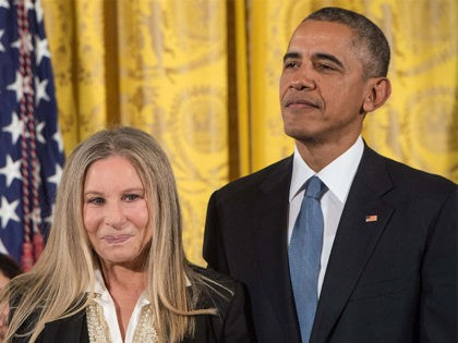 US President Barack Obama and singer and actress Barbra Streisand attend a Presidential Medal of Freedom ceremony at the White House in Washington, DC, on November 24, 2015. AFP PHOTO/NICHOLAS KAMM / AFP / NICHOLAS KAMM (Photo credit should read NICHOLAS KAMM/AFP/Getty Images)