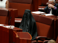 Senator Pauline Hanson wears a burqa during question time in the Senate chamber at Parliament House in Canberra, Australia, Thursday, Aug. 17, 2017.