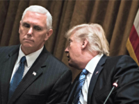 Pence Listens to Trump BRENDAN SMIALOWSKI, AFPGetty Images