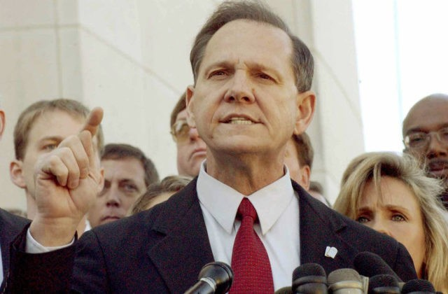 FILE PHOTO: Alabama Chief Justice Roy Moore faces the media after being removed from office in Montgomery, Alabama, U.S. November 13, 2003. REUTERS/Bob Ealum/File Photo
