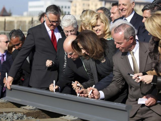 Signing high-speed rail track (Gary Kazanjian / Associated Press)