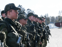 Young recruits are pictured during an inspection on March 2, 2017 at the regiment in Enkoping, 70 km north-west of Stockholm.
