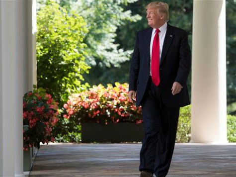 US President Donald Trump walks down the West Wing Colonnade to speak to the American Legion Boys Nation and the American Legion Auxiliary Girls Nation in the Rose Garden of the White House in Washington, DC, July 26, 2017. / AFP PHOTO / SAUL LOEB (Photo credit should read SAUL …