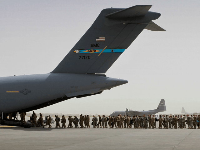 In this Thursday, July 14, 2011 file photo, U.S. soldiers board a U.S. military aircraft as they leave Afghanistan, at the U.S. base in Bagram, north of Kabul, Afghanistan. U.S. A bill passed by Congress allowing the families of 9/11 victims to sue the Saudi government has reinforced to some …